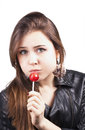 Licking lollipop woman on white Stock Photo