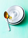 Lid and spoon Stock Image