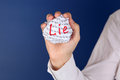 Lie crumpled paper ball with word in woman hand Royalty Free Stock Image