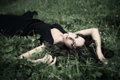 Lie in grass beauitful elegant mature woman Stock Photography