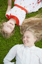Lie with mum and daughter outside in the park Royalty Free Stock Photo