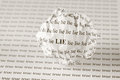 Lie or true crumpled paper ball with words on background with words sepia Royalty Free Stock Image
