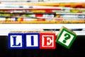 Lie word near many newspapers Stock Photo