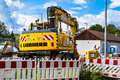 Liebherr excavator digger on a construction site with lots of strabag badges Stock Photo
