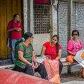 Life as it is waiting the bus a photo of some women sitting in stop area to pick them up to their targeted place Stock Photo