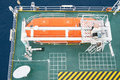 Life boat, survival craft or rescue boat at oil and gas platform for emergency evacuate at muster station Royalty Free Stock Photo