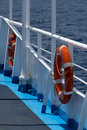 Life bouys two lifebuoys on fence of the ship deck with the sea in the background small dof shallow focus Stock Photos