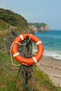 Life buoy on the beach Royalty Free Stock Photo