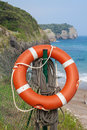 Life buoy on the beach Stock Photo