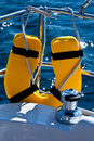 Life buoy and capstan on sailing yacht Stock Images