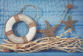 Life buoy decoration on blue shabby background Stock Image