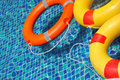 Life buoy floating in swimming pool Royalty Free Stock Photo