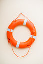 Life buoy hanging on the wall r Royalty Free Stock Photo