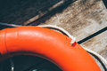 Life buoy hanging on wooden wall Royalty Free Stock Photo