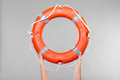 Life buoy ring in female hands Royalty Free Stock Photo