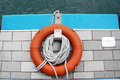 Life buoy and rope ropes for rescue purposes by the victoria harbor in hong kong Stock Image