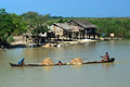 Daily life in canal near inle lake myanmar january traditional villagers suction river sand wooden boat on january shan state Royalty Free Stock Photography