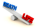 Life death balance on one side and on another weight scale with text in red and blue white background Royalty Free Stock Images