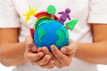 Life on earth environment and ecology concept with clay globe in child hands Royalty Free Stock Images