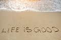 Life in good written on sand beach - positive thinking concept Royalty Free Stock Photo
