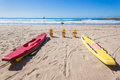 Life guard skis rescue buoys ocean waves beach and at durban beaches south africa photo image overlooking and safety signs with Royalty Free Stock Photography