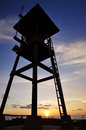 Life guard tower on sunset sky