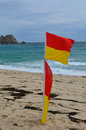 Life guard warning flags on a Cornish beach. Royalty Free Stock Photo