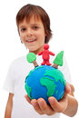 Life in harmony with nature concept boy holding earth globe trees and man made of colorful clay Royalty Free Stock Photos