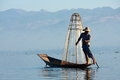 Life at inle lake myanmar february fisherman catches fish for food on february on intha people possess the leg rowing Stock Images