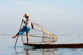 Life at inle lake myanmar february fisherman catches fish for food on february on intha people possess the leg rowing Royalty Free Stock Images