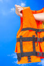 Life jacket with hand on blue sky Stock Image