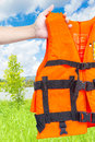 Life jacket orange with hand be ready Royalty Free Stock Photo
