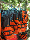 Life jackets hanging on clothesline Stock Photography