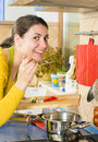 Life in the kitchen beautiful smiling woman preparing fresh meal Stock Image