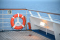 Life preserver on cruise ship railing at dusk Royalty Free Stock Photography