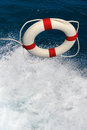 Life preserver falling on water thrown into splashing Royalty Free Stock Image