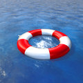 Life preserver floating in a clear pool water Royalty Free Stock Images