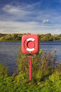 Life preserver by a lake the edge of the for safety Royalty Free Stock Photos