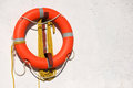 Life preserver on white concrete background a Royalty Free Stock Photography