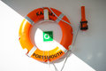 Life preservers on white wall life buoy on the deck of cruise ship a device made buoyant or inflatable material such as a jacket Stock Images