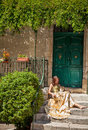 Life in provence woman sitting on the porch and stroking a cat france tiny town of sault beautiful dress is of house Royalty Free Stock Photos