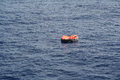Life Raft adrift on the Ocean Royalty Free Stock Photo