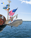 Life raft or transport boat on old ship a an whip along with weather and navigation equipment bouy and american flag Stock Photo