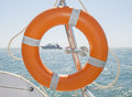 Life ring on a boat safety equipment in tropical sea Stock Photo