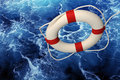 Life ring Falling On Churning Water Royalty Free Stock Image