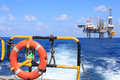Life ring on the offshore supply boat with Jack up drilling rig Royalty Free Stock Photo