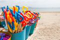 Life s a beach plastic spades in plastic buckets on sale on Stock Photography