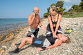 Life saver cpr training on a scuba diver on a beach Royalty Free Stock Images