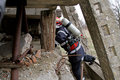 Life saver rescuer searching for victims in ruins of damaged building Stock Photography