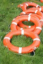 Life-saving buoys on the grass Royalty Free Stock Photos